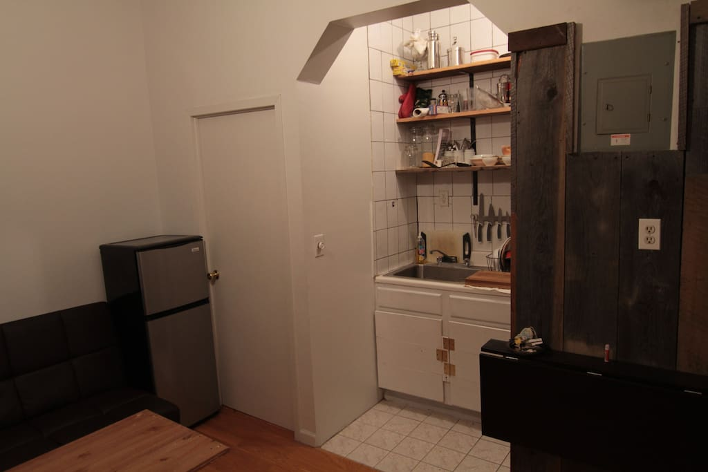 kitchen area with fold out table attached to wood column.