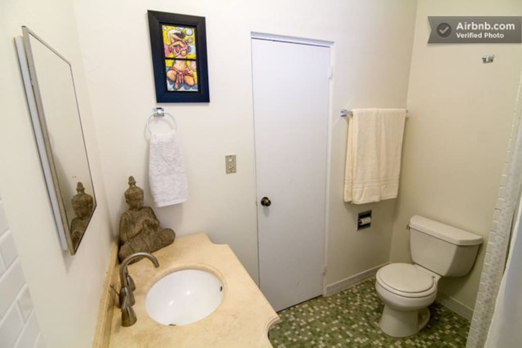 This hallway bathroom is to be shared by house guests