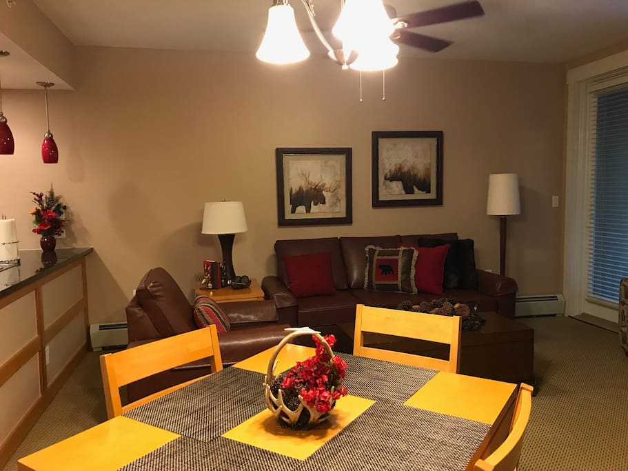4 person dining table with a view of the spacious living room. Recently remodeled and upgraded. True Rocky Mountain style, walk out deck to hot tub.