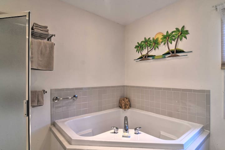 The bathroom is equipped with a large vanity, walk-in shower and tub.