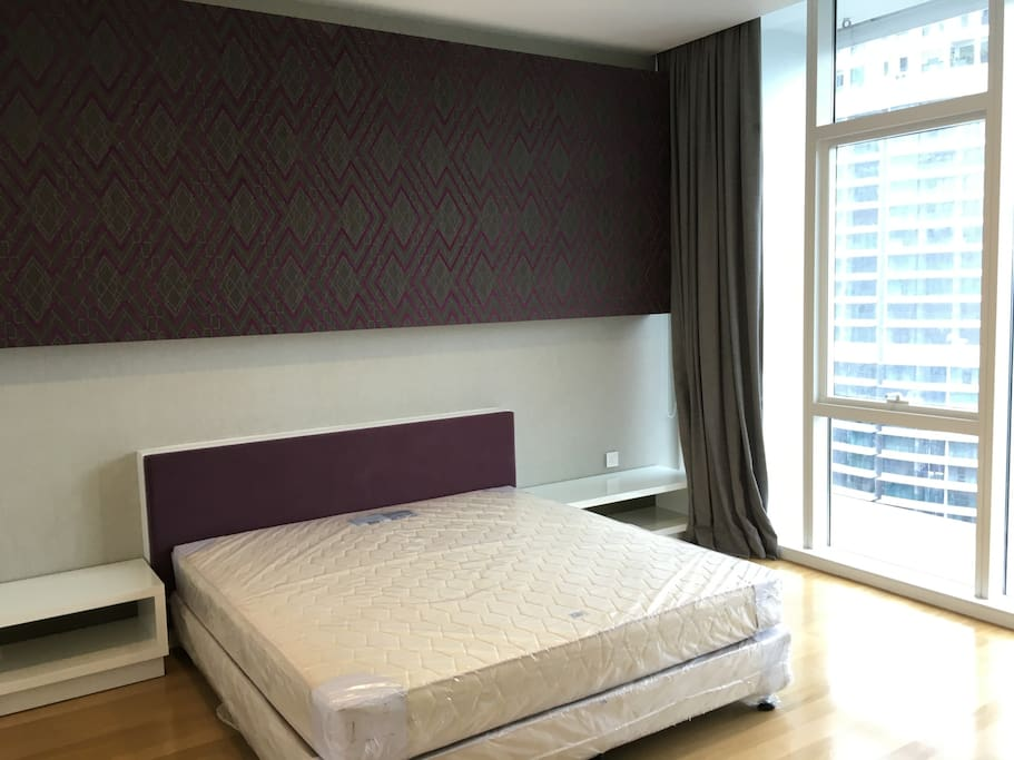 large bedroom with walk in closet and en suite