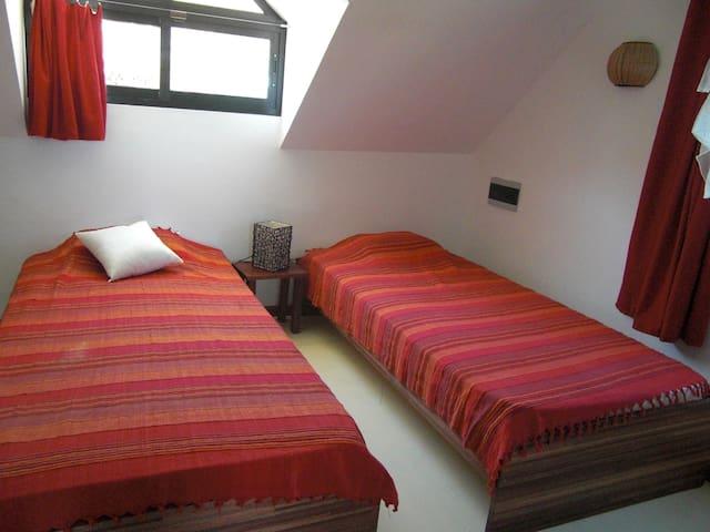 Le Morne Cottage singe bed room