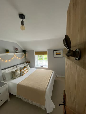 Calm and comfortable bedroom with purbeck hill views.