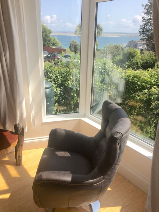 Bay window swivel chair overlooking St.Ives Bay