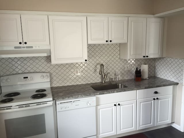 Dishwasher, granite countertops, electric stove.