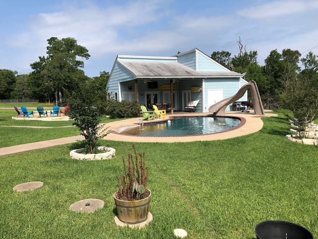 VIEW OF GUEST HOUSE AND POOL WITH FIRE PIT 5-30-19