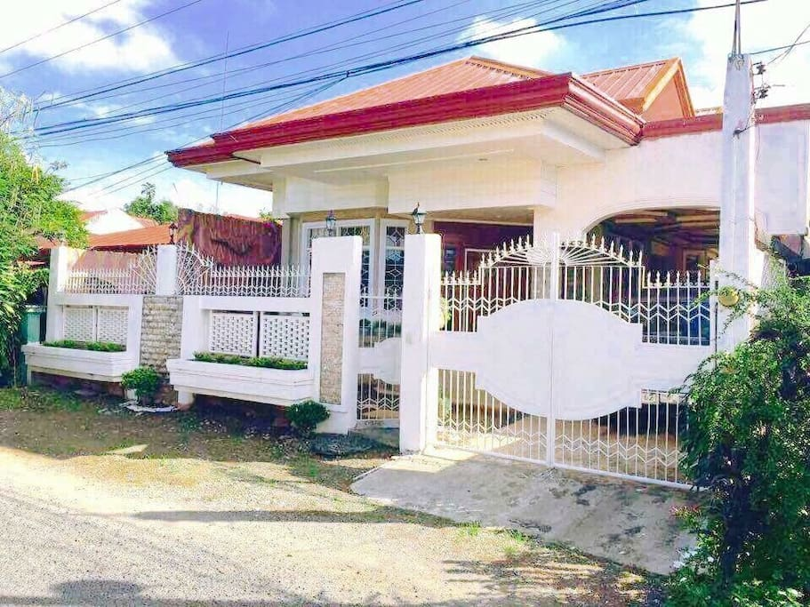 The Front gate . House is secure and gate front and back.