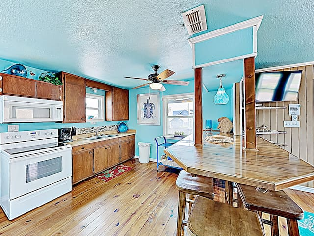 Whip up family favorites in the kitchen, equipped with a double-basin sink, refrigerator, electric stove, microwave, and coffee maker.