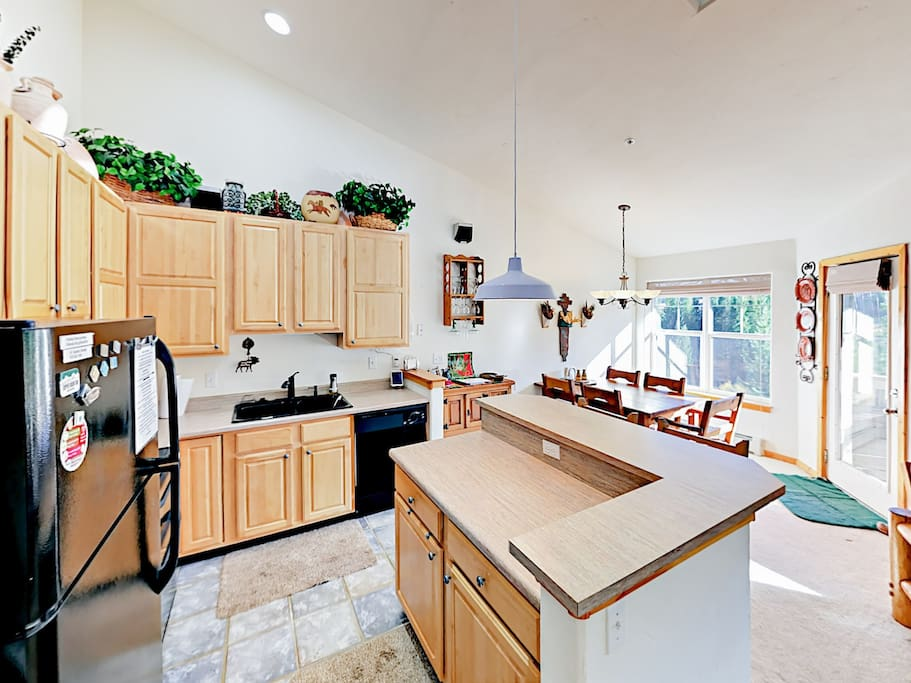 The well-equipped kitchen features a double oven and dishwasher.