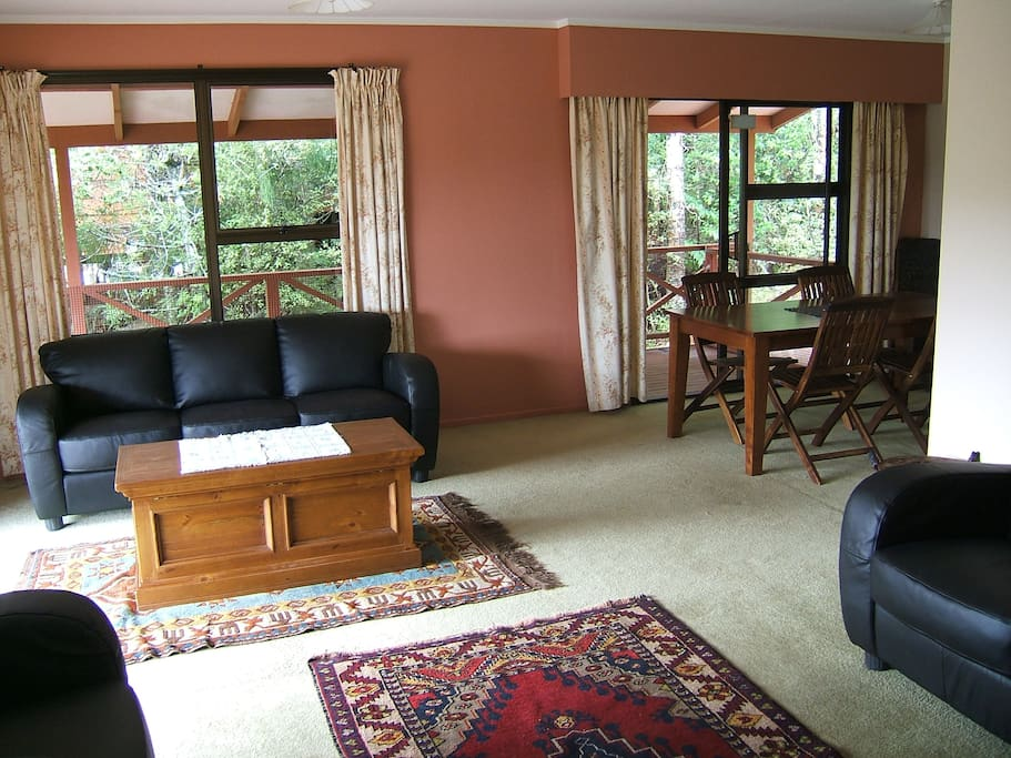 Spacious living room with open plan dining area.