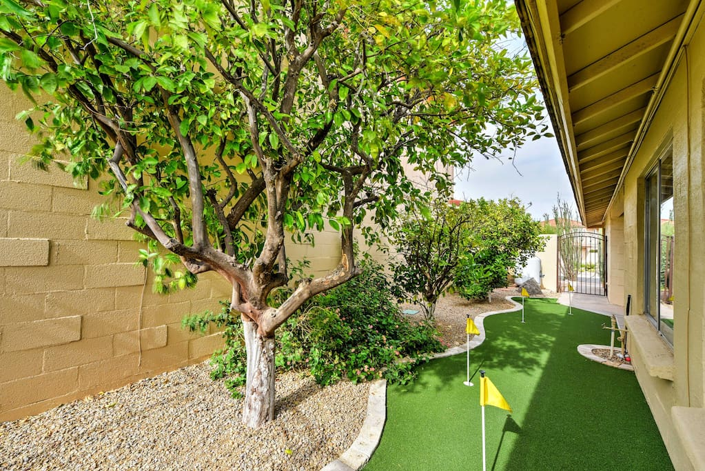 Equipped with a putting green, swimming pool, and lounge area, look no further than the backyard for all your leisure activities.