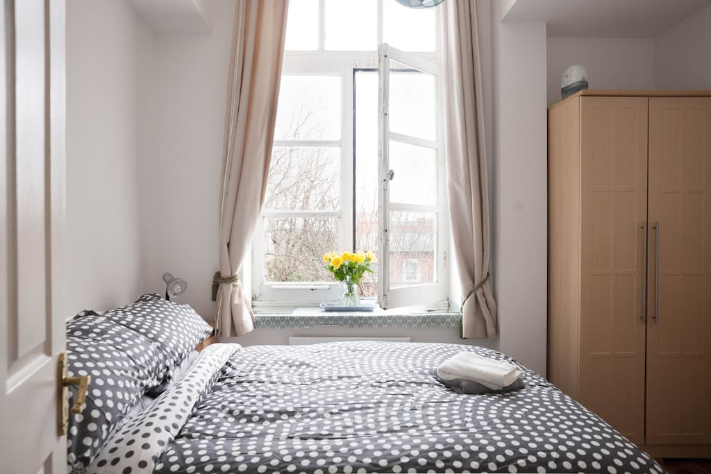 Double bedroom, large windows to leafy exterior.