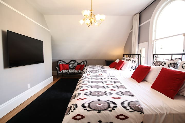 Black&Red bedroom with two beds and private bath