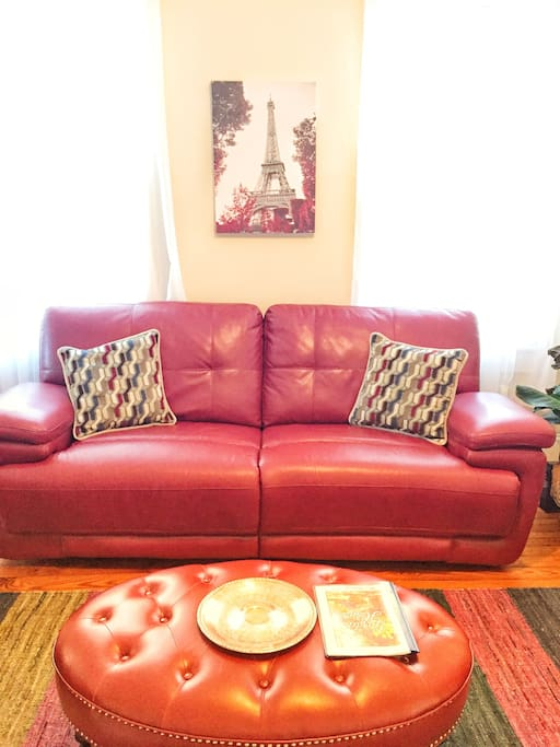 The living room furniture is new and comfortable. The couch is a double recliner.