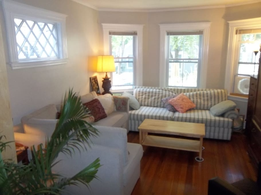 Living Room (Bay Window View) Sleeps 3 Guests on Queen Pullout-Sofabed & Single Sleeper-Sofa