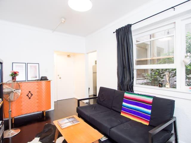 Living room looking towards apartment entry door