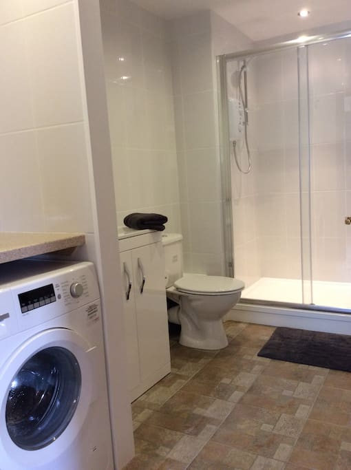 Spacious Shower room with laundry facilities