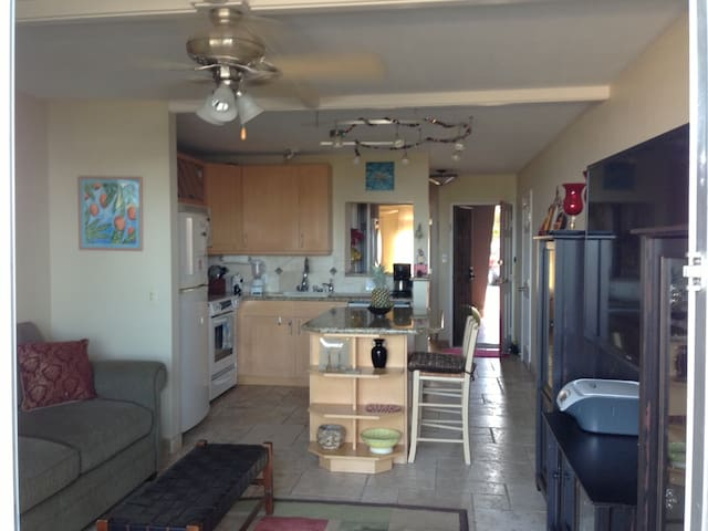 fully stocked kitchen with island, four stools.  granite countertops