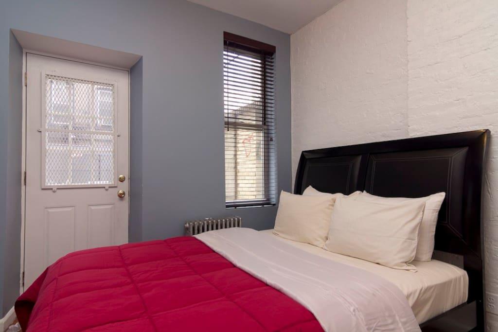 Queen Bedroom with door to outdoor space