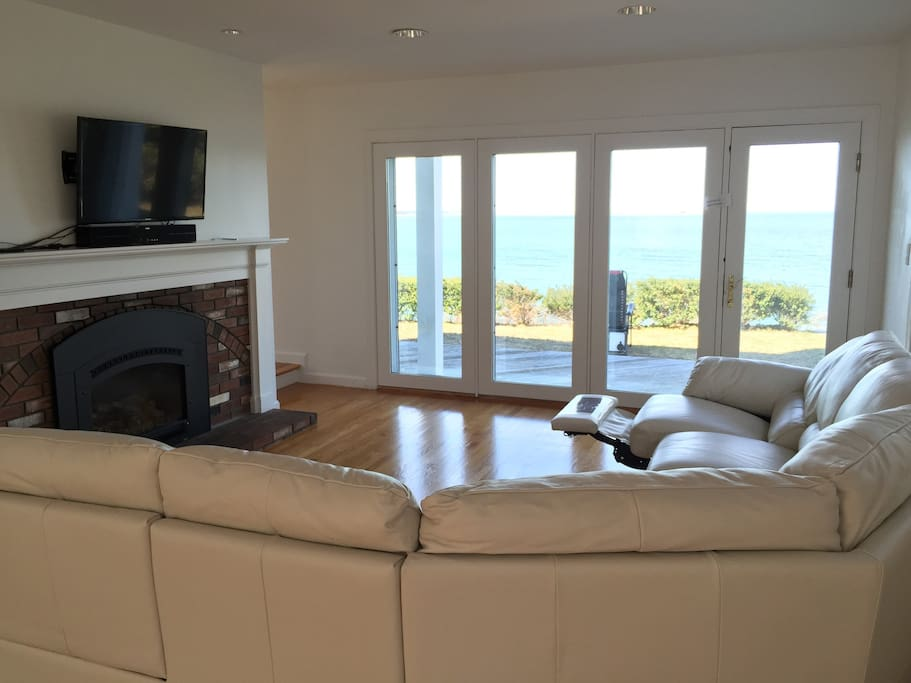 Recline on the sofa while watching tv and looking out into the bay