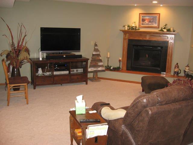 Gas fireplace, large screen TV.