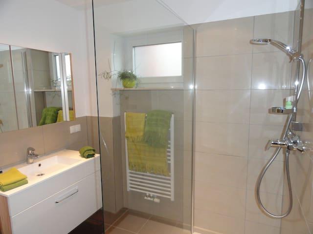 modern bath room with washing machine