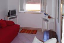 Wohnzimmer mit 2. Einzelbett