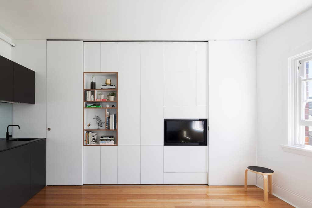 the apartment has a joinery wall which incorporates everything you'll need for your stay - A bedroom, bathroom, tv, books and storage.
