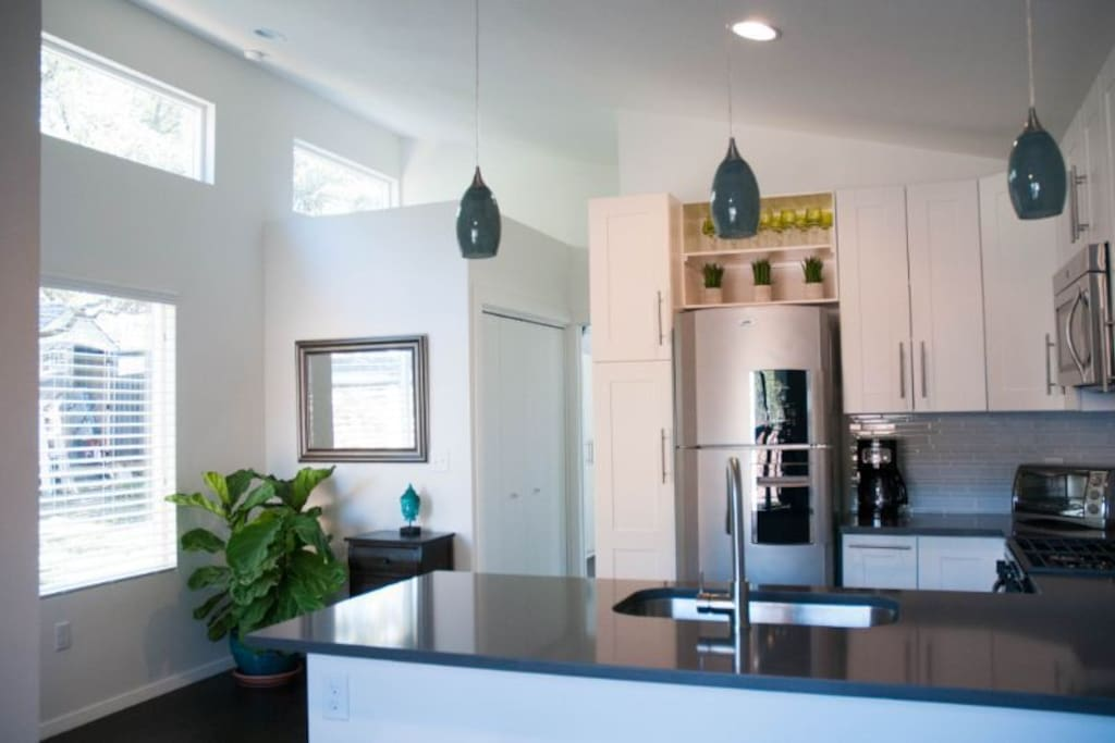 Bright, open layout with full kitchen, living space, bedroom and full bath. Additional workspace at bar, if needed.