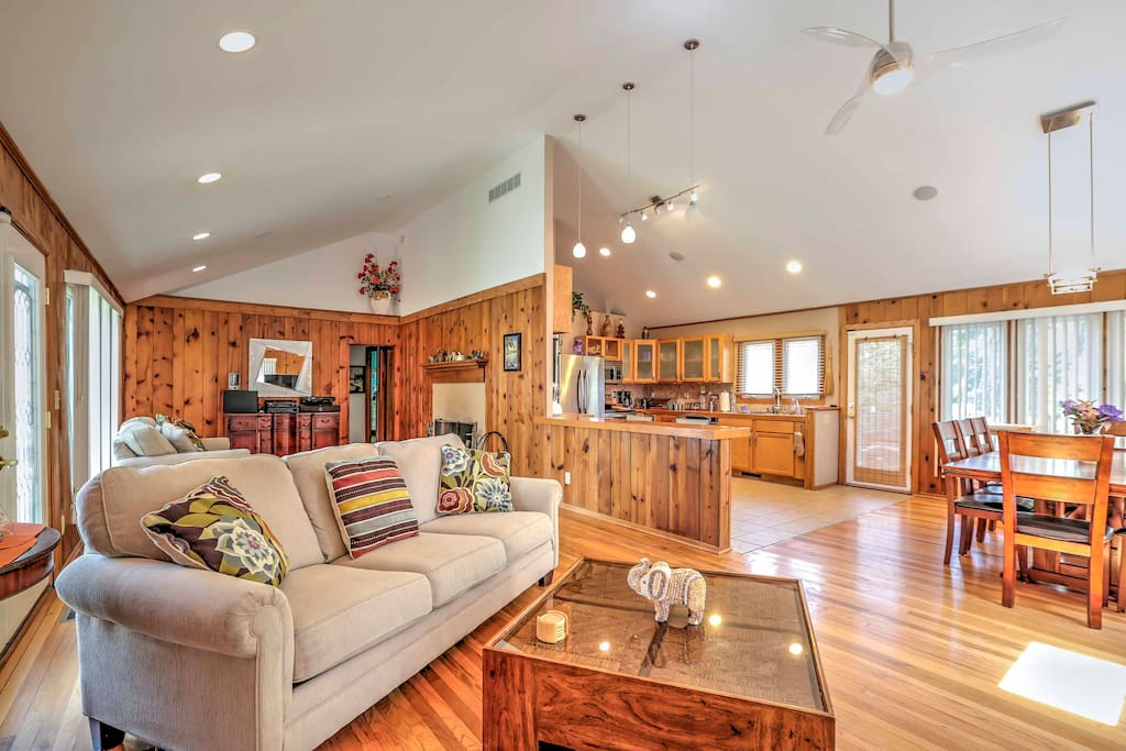 The cabin-like living space features vaulted ceilings and hardwood floors.