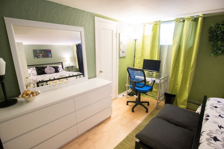 1st bedroom has a large dresser and a deep closet