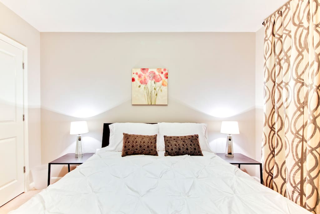 Comfy private bedroom with a queen platform bed.