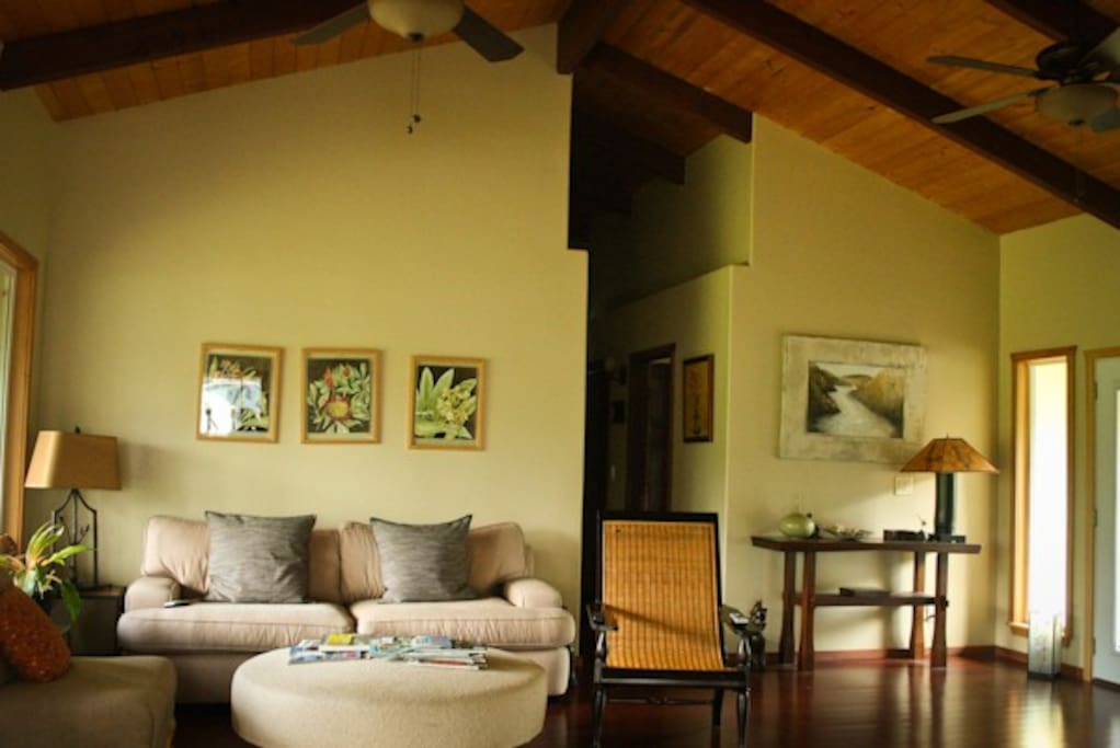 Living room area with open floor plan and vaulted ceilings
