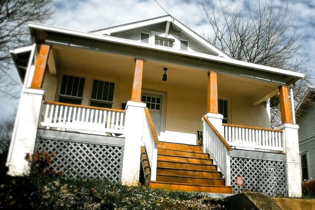 Front of bungalow with spacious porch for relaxing in the sun.