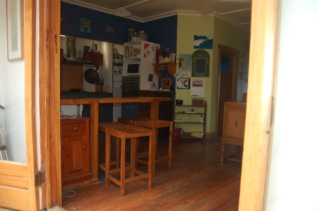Open plan rustic kitchen viewed from dining area