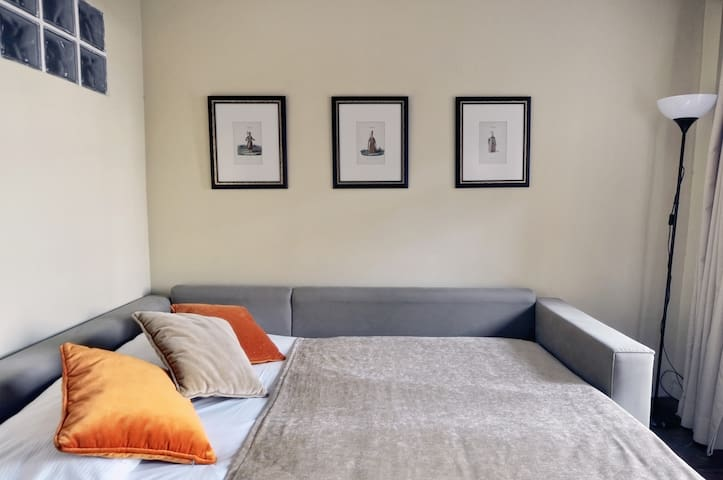 Lower level sofa bed converted into a double bed