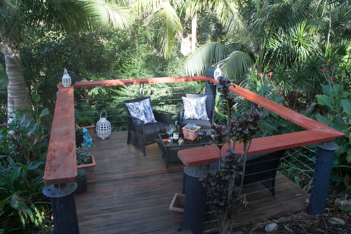 Tranquil decking amidst the garden private for the cottage guests.