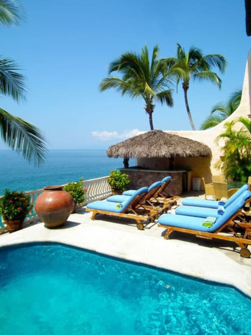 One of the three terraces, heated pool, sunbeds and palapa bar