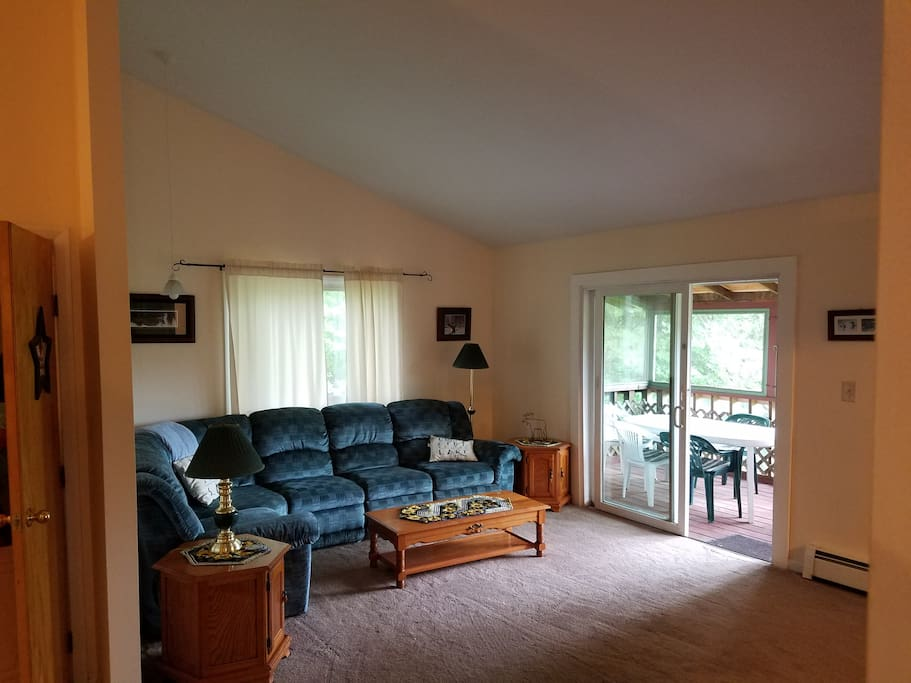 Large living room, connected to the deck.