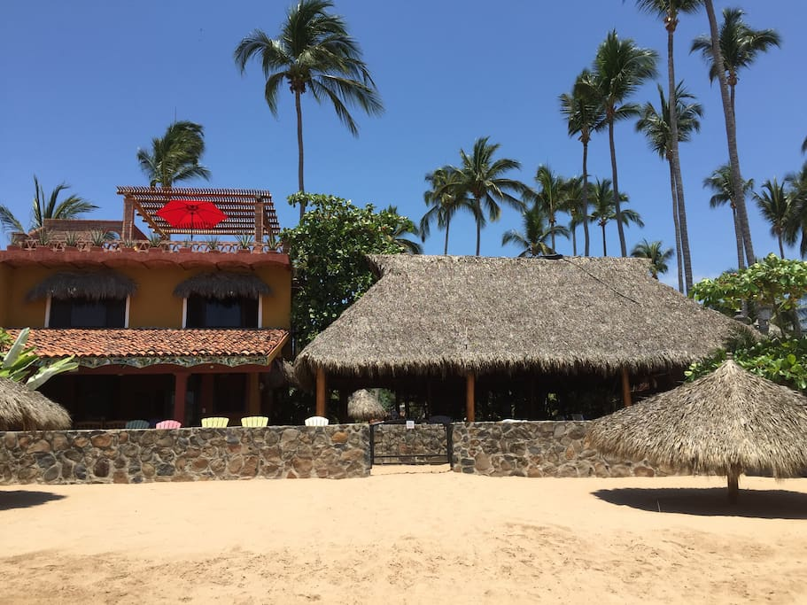 Private beach area with palapa