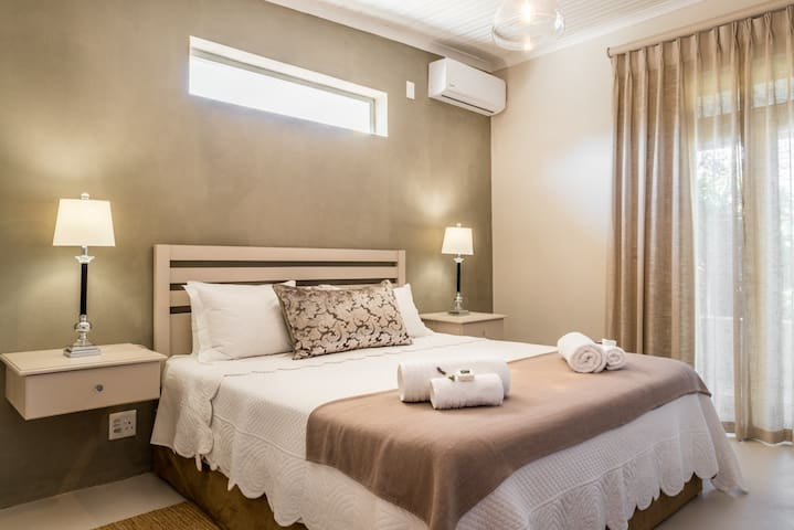 Master bedroom with king size bed and A/C