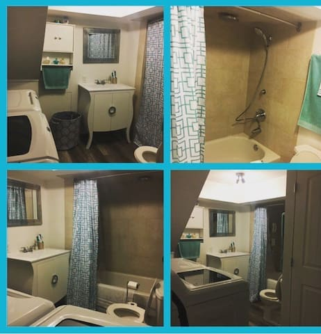 Washroom with shower/tub and washer/dryer
