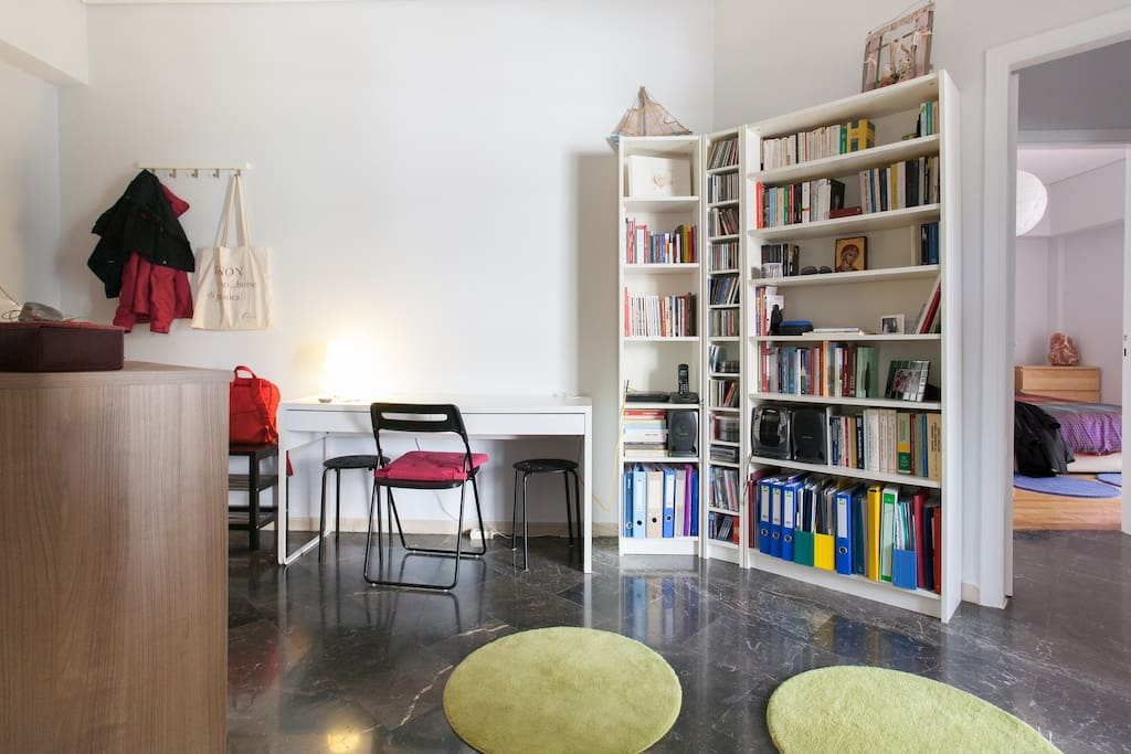 A desk hosts your notebook, wifi available, small library to entertain you.