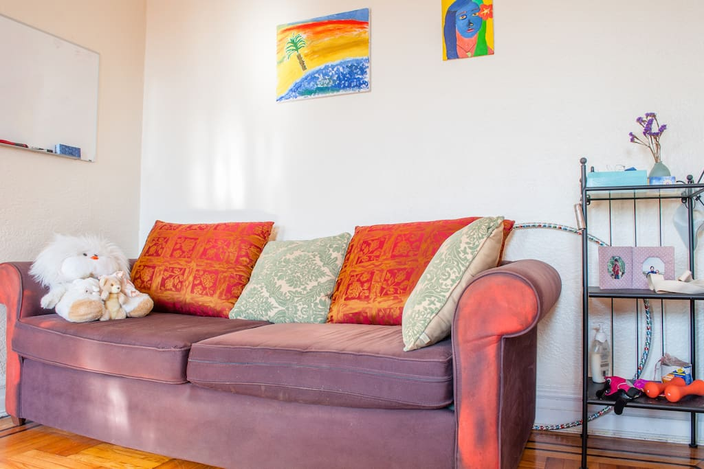 Huge living room, sunny and well-lit. Comfy futon couch too for extra guests!