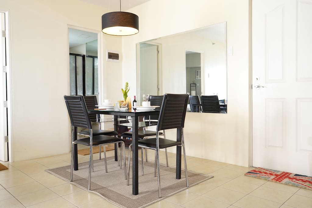 COMPACT DINING table, sits four (4) persons, main door (on right) and bathroom (on background)