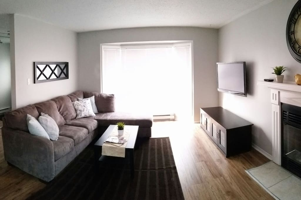 """Beautiful large sectional couch and 42"""" TV"""