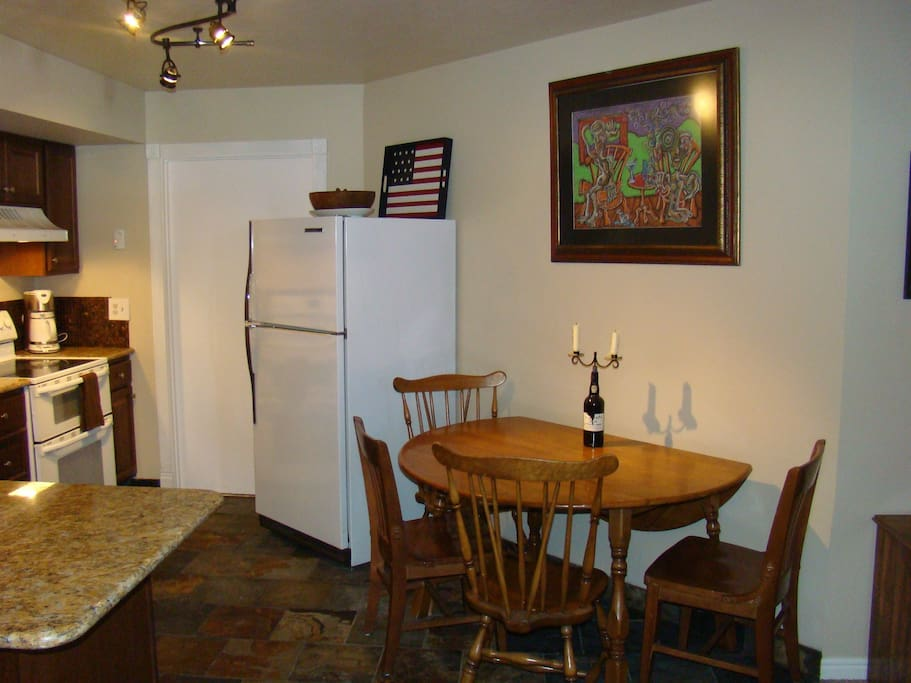 Another view of kitchen and dining area with expandable table.