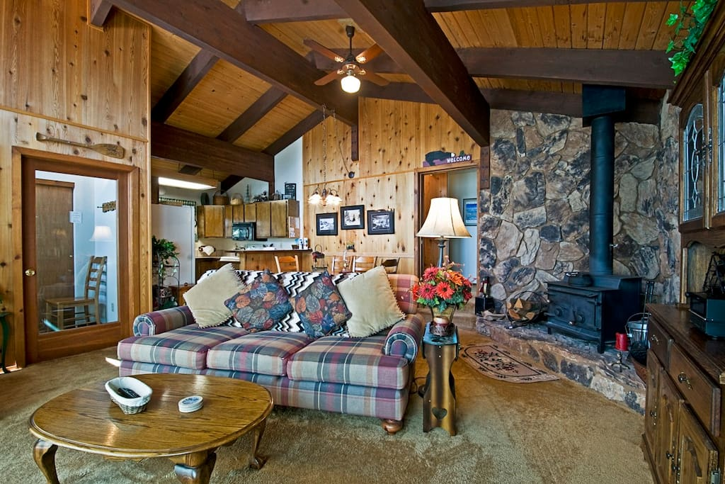Living room, with fireplace/wood stove. Airlock foyer at left.