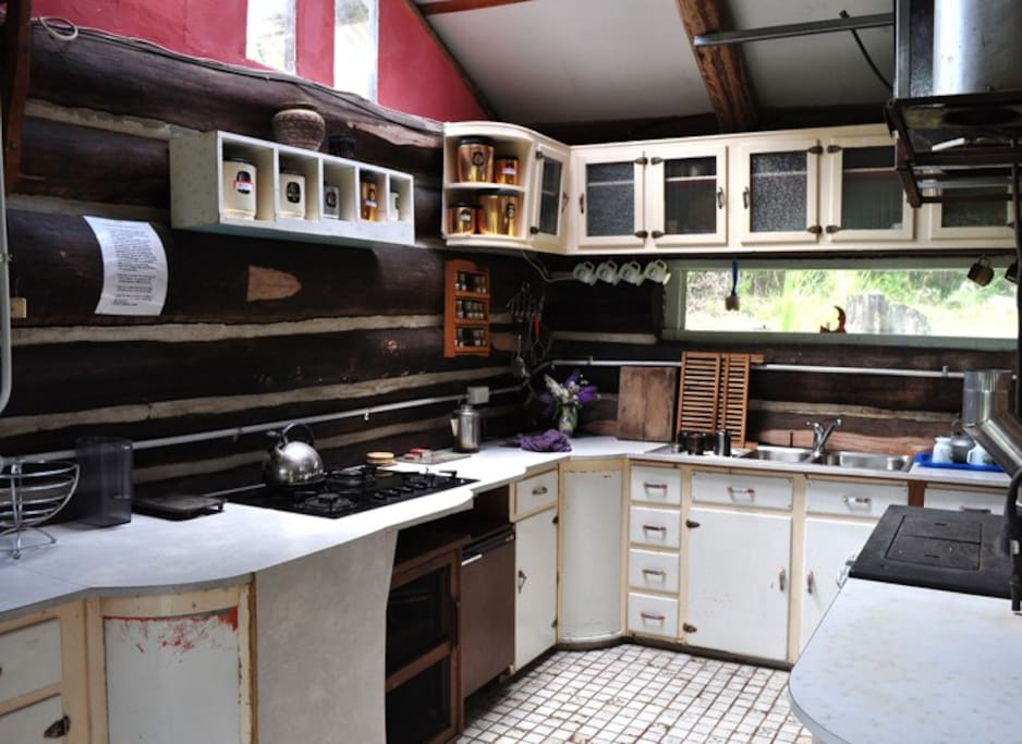 The 1950's inspired kitchen including full gas cooktop and wood fired cooker as well