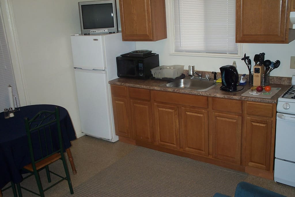 From near the entry door, here's a view of the kitchen / dining / living room area.